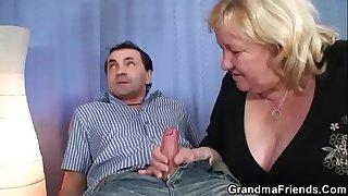 Big grandma takes two dicks