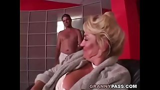 Busty Grandma is getting her..