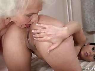 Lusty granny gets wet by a..