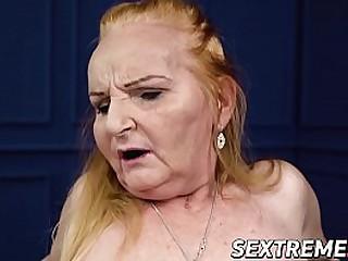 Redhead granny rides cock..