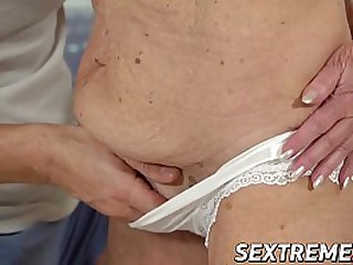 Kinky granny pounded by a y...