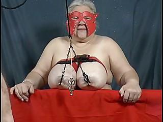 Granny has her heavy tits..