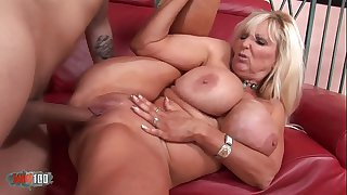 Busty mature babe banged by..